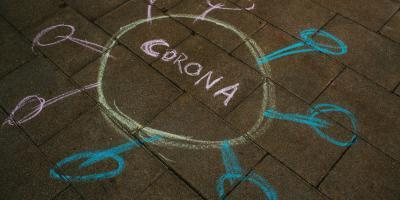 Corona chalk drawing on the ground