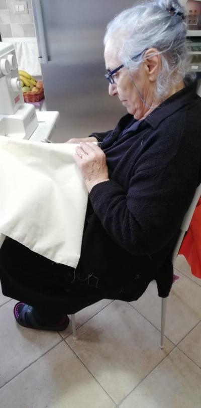Volunteer in Nuoro sews our conference bags